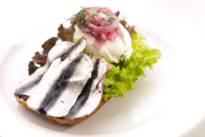 Spiced baltic sprat sandwich with marinated red onion and poached egg | Cafe Boulevard in Tallinn